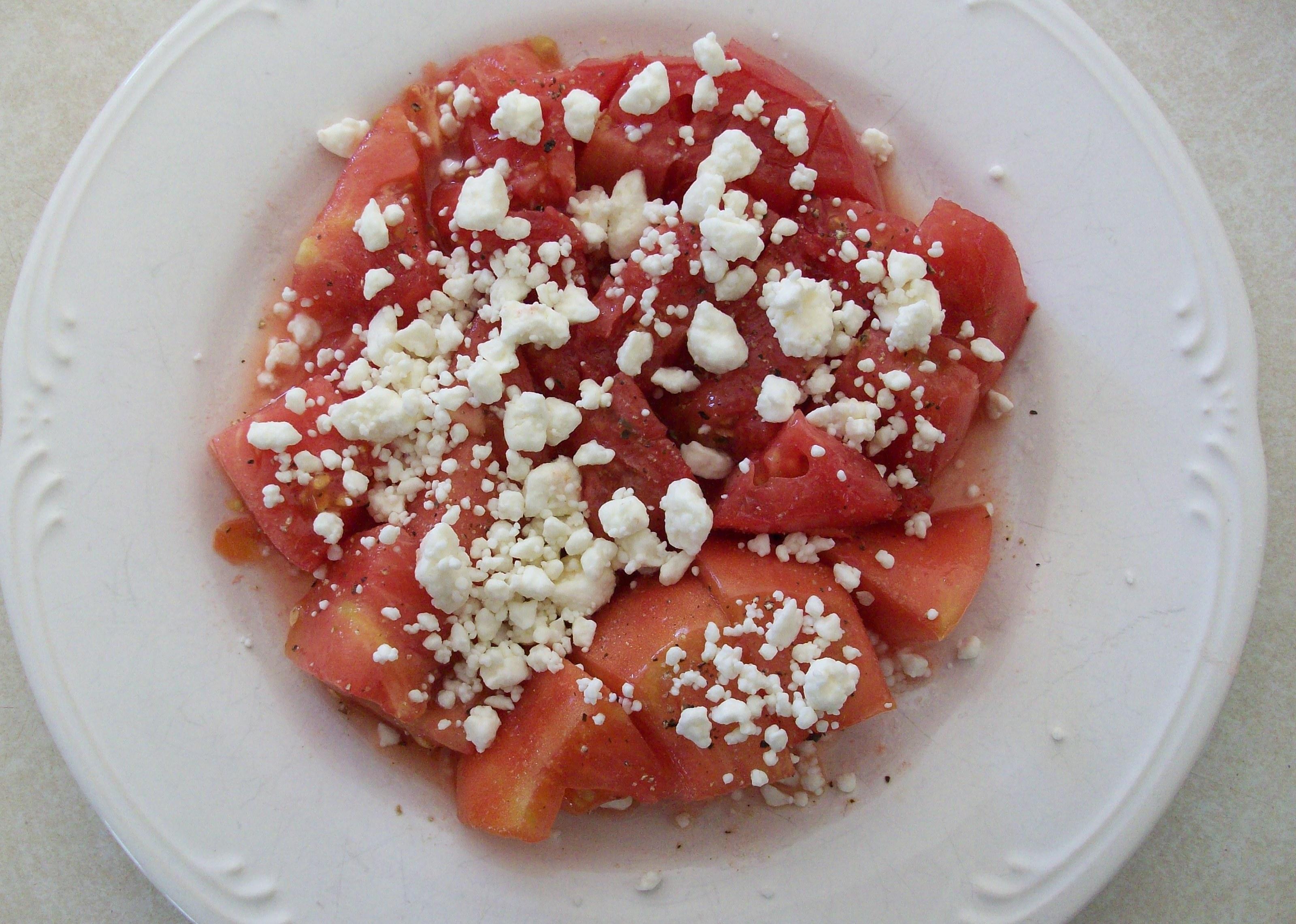 Gardener's Breakfast of tomato, salt, pepper and feta cheese.