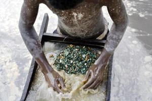 Youth cleaning cobalt ore Photo Credit - Getty Images
